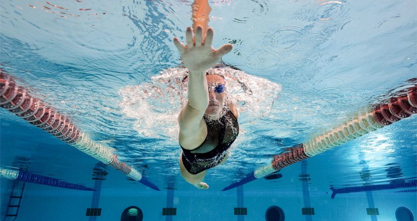 How often should one do swimming for it to be effective in alleviating lower back pain?